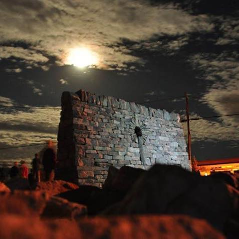 Celtic Cross at night in a wall constructed during the 2015 International Irish-Canadian Dry Stone Festival opposite the Island school on lands owned by Eloise and Dayle Gowan